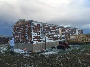 Hilfe Winterprojekt Lakota Indianer USA zerstoerte Haeuser