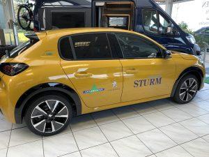 1222-Autoscheibentoenung-Sonnenschutzfolie-schwarz-mittel-Autohaus-Sturm-kleben